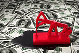 Red Pumpjack And Spilled Oil On The Money