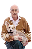 Cute grandpa with a dog sitting on his hands.