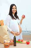 Pregnant woman eating the apple