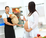 pregnant woman with a cup in her hands