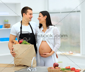 pregnant woman and her husband prepare