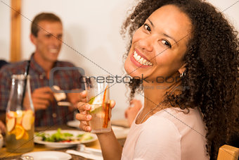 Afro-american woman having a drink