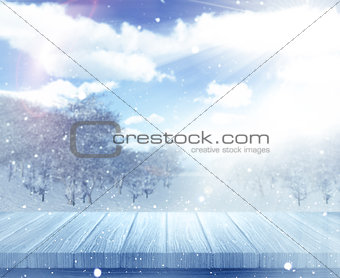 3D wooden table against a defocussed snowy landscape