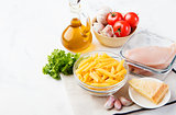 Italian food ingredients: pasta, tomatoes, chicken