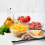 Italian food ingredients: pasta, tomatoes, minced