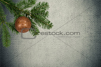 green branch with christmas ball on canvas background