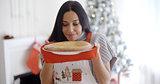 Attractive young woman baking tarts for Xmas