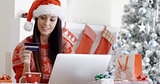 Smiling woman doing online Christmas shopping