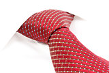 red tie knotted the double Windsor