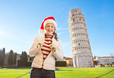 Portrait of woman in Santa hat in front of Leaning Tour of Pisa