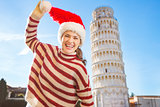 Laughing woman in Santa hat in front of Leaning Tour of Pisa