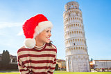 Woman in Santa hat looking on something near Leaning Tour, Pisa