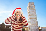 Woman in Santa hat looking up in front of Leaning Tour of Pisa