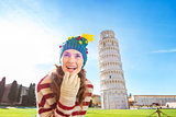 Woman in Christmas tree hat near Leaning Tour of Pisa