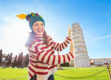 Woman in Christmas tree hat supporting Leaning Tour of Pisa