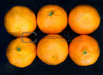 Six clementines in rows