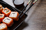 Sushi roll with chopsticks