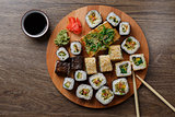 Sushi set at round wooden plate