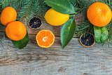 Tangerines, lemons and spruce branches.