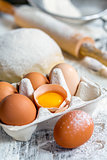 Tray with eggs, dough and rolling pin.