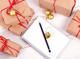 wish list in to notebook near christmas gifts