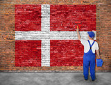 House painter paints flag of Denmark