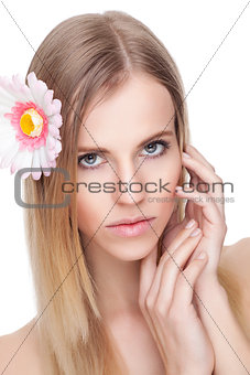 Beautiful woman with a flower in her hair