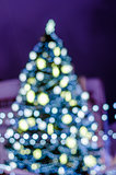 Decorated Christmas tree. Blurred lights background