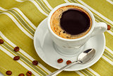 Black coffee in white porcelain cup