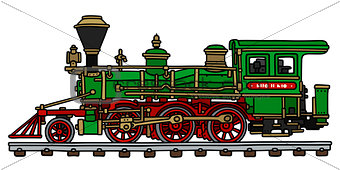 Old green american steam locomotive