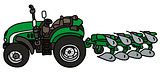 Green tractor with a plow