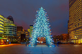 Christmas tree among the skyscrapers in Paris, France.