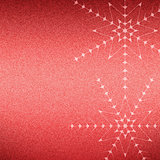 Christmas snowflakes on a red jeans texture background.