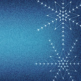 Christmas snowflakes on a blue jeans texture background.