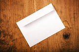 Blank white mailing envelope on office desk