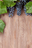 Red grape on wooden table
