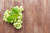 Bunch of grapes on wooden table