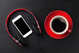 Headphones, smartphone and coffee cup