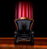 black armchair and red drape