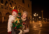 Mother and child with Christmas tree on Piazza San Marco, Venice
