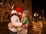 Mother and child with Italian flag on Piazza San Marco in Venice