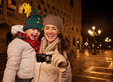 Mother and child looking on photos on Piazza San Marco in Venice