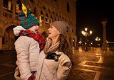 Happy mother with camera and child on Piazza San Marco in Venice