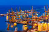 Sea cargo port at night in Barcelona, Spain.