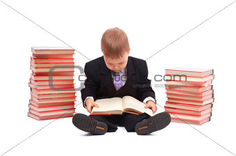Boy with books for an education portrait