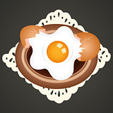 Fried egg on dish background