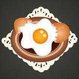 Fried egg on dish background