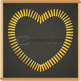 Slate blackboard with french fries shaped heart