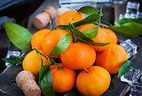 Fresh tangerines on holiday background