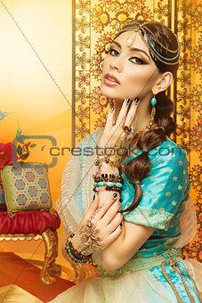 Beautiful girl in oriental costume